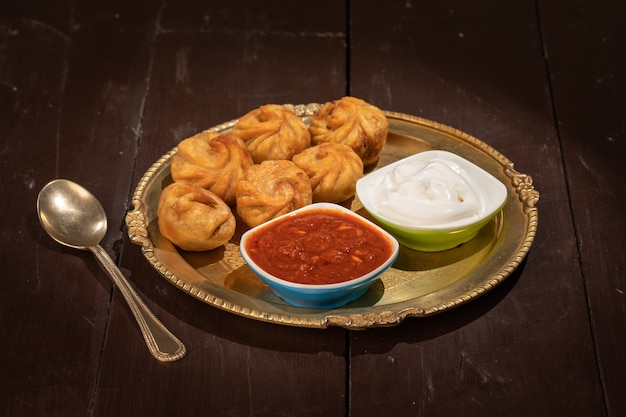 Traditional dumpling momos served with sauce