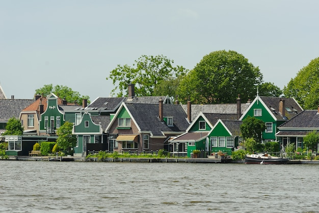 Traditional dutch houses near the canal in summer day. netherlands