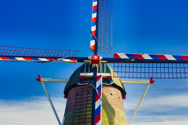 Traditional dutch windmill under blue skies in the netherlands, close-up