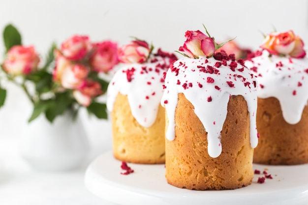 Traditional easter bread decorated sugar icing, raspberries and flowers