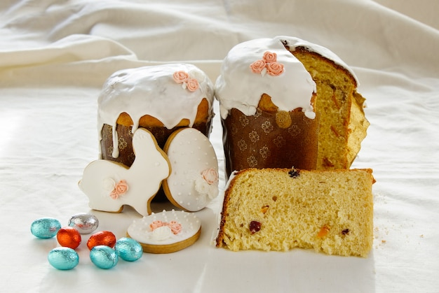 Traditional easter, sweet bread decorated meringue and blue candy cane shape eggs on plate