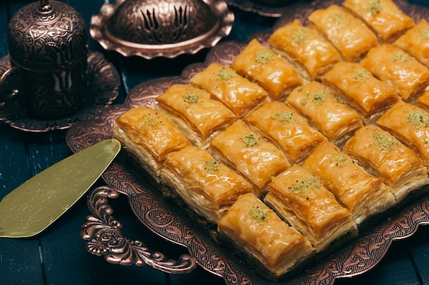 Traditional eastern desserts on wooden surface