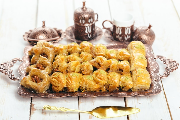 Traditional eastern desserts on wooden table
