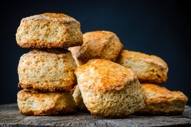 Traditional english cheese buns scones on wooden table on dark background