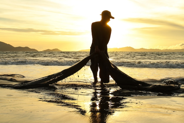 Traditional fishermen catch fish in the sea