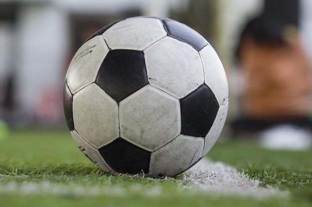 Traditional focus soccer ball on soccer field