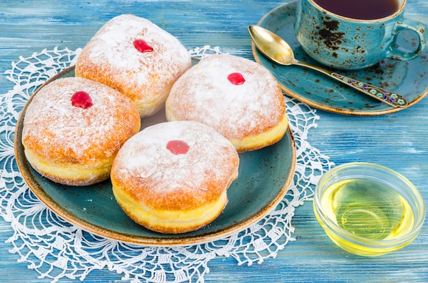 Traditional food doughnuts with icing sugar and jam. concept and background jewish holiday hanukkah.