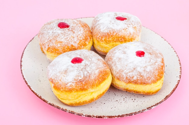 Traditional food doughnuts with icing sugar and jam.jewish holiday hanukkah.