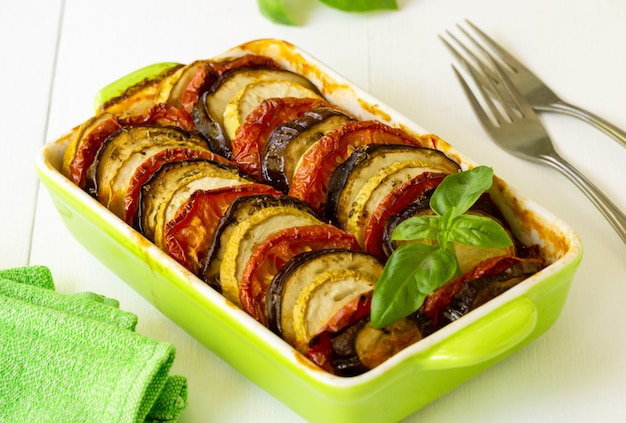 Traditional french dish ratatouille. vegetable casserole with eggplant, tomato and zucchini in a ceramic form