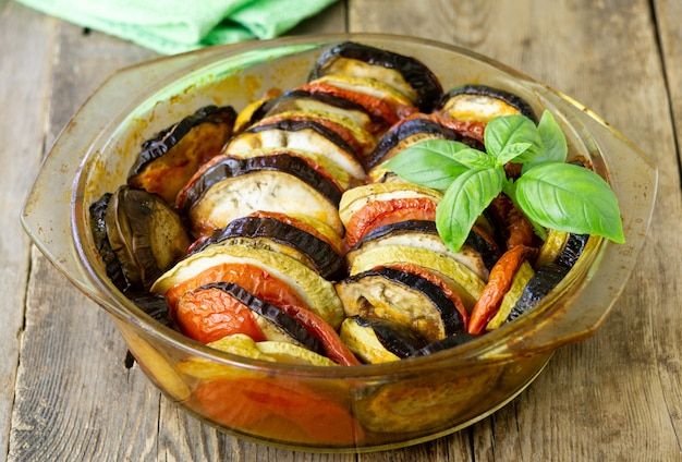 Traditional french dish ratatouille. vegetable casserole with eggplant, tomato and zucchini in a glass form
