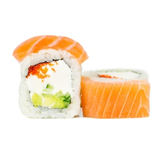 Traditional fresh japanese roll with salmon, nori, philadelphia, tobico, avocado and cucumber
