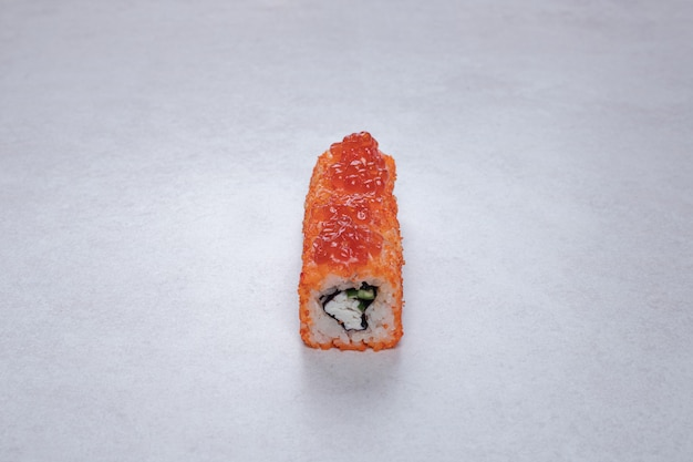 Traditional fresh sushi rolls on white background.