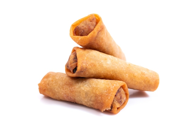 Traditional fried chinese crispy vegetable rolls isolated on a white background.