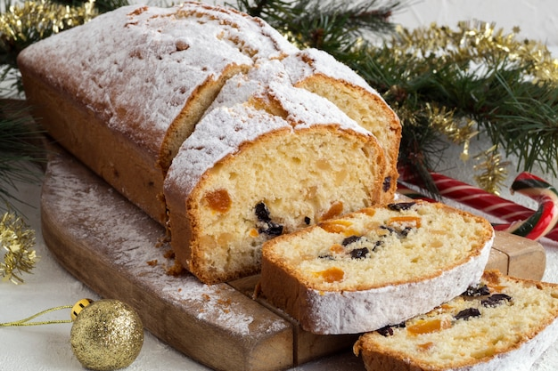 Traditional fruit cake for christmas with raisins, nuts. with christmas .