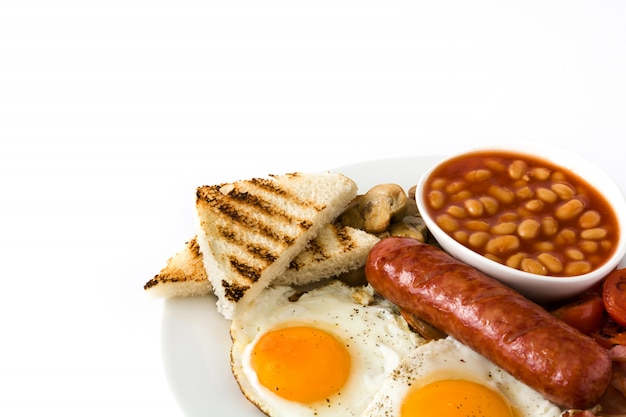 Traditional full english breakfast with fried eggs, sausages, beans, mushrooms, grilled tomatoes and bacon on isolated on white surface