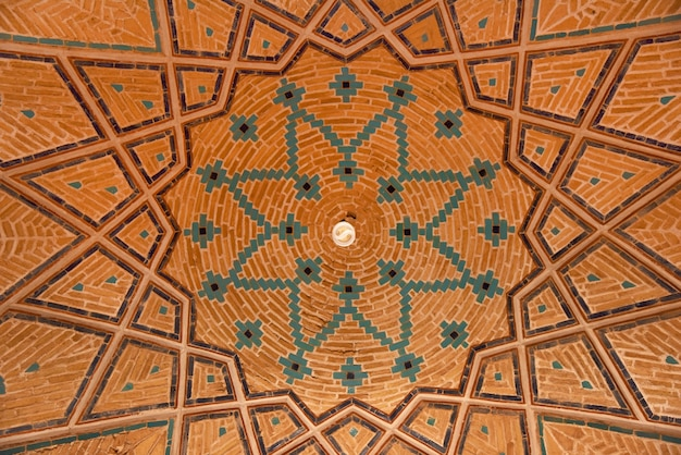 Traditional geometric pattern on the vaulted ceiling of the agha bozorg  mosque