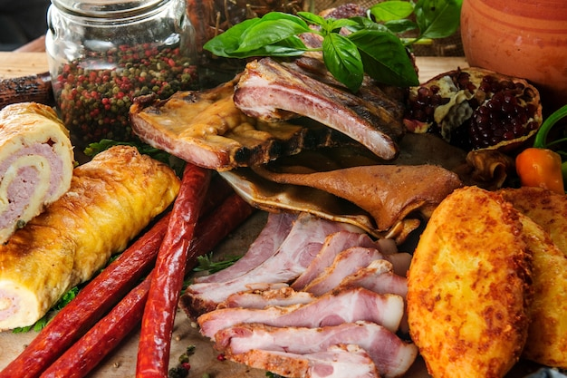 Traditional georgian meat dishes on wooden background.