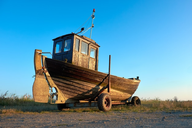 Traditional german fisherman boat on a seashore of baltic sea on island rugen