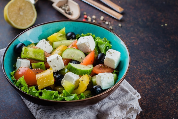 Traditional greek salad with fresh vegetables, feta cheese and black olives