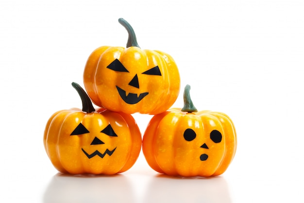 Traditional halloween plastic pumpkins with scary faces