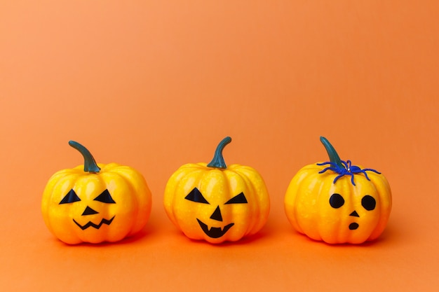 Traditional halloween pumpkins with scary faces