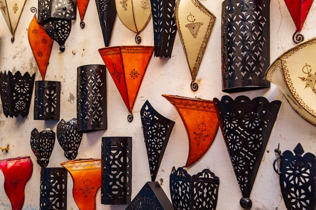 Traditional handmade moroccan lamps in the gift shop. colored glass mosaic. bazaar in essaouira, morocco.