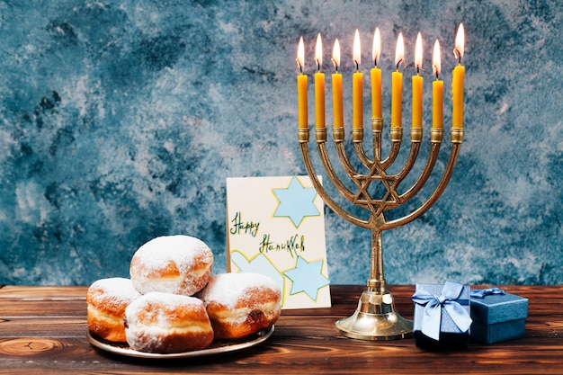 Traditional hanukkah sweets with candles