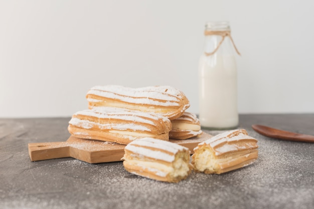 Traditional homemade eclairs with milk bottle