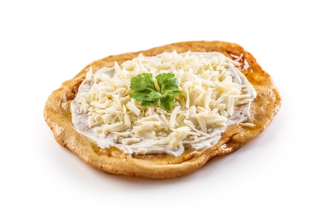 Traditional huangarian creamy langos with cheese, garlic and herbs.