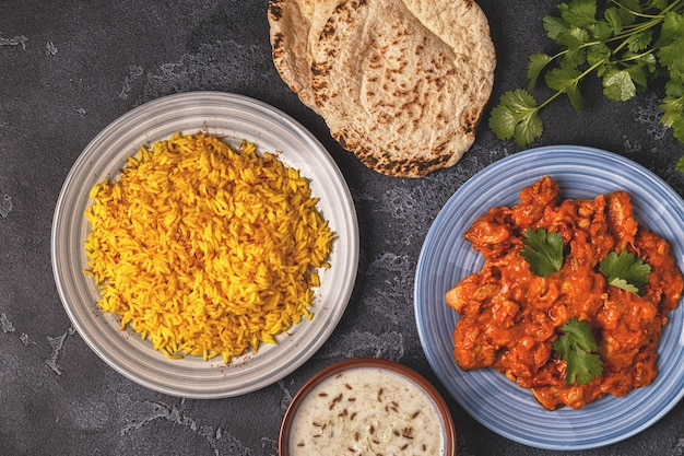Traditional indian curry with rice and bread raita