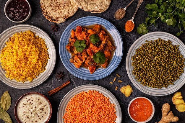 Traditional indian curry with rice, lentils and mung beans