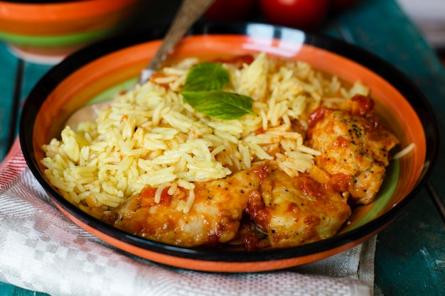 Traditional indian dish with rice and chicken close-up