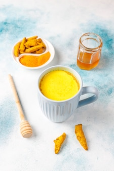 Traditional indian drink turmeric golden milk .
