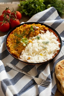 Traditional indian food with rice and tomatoes