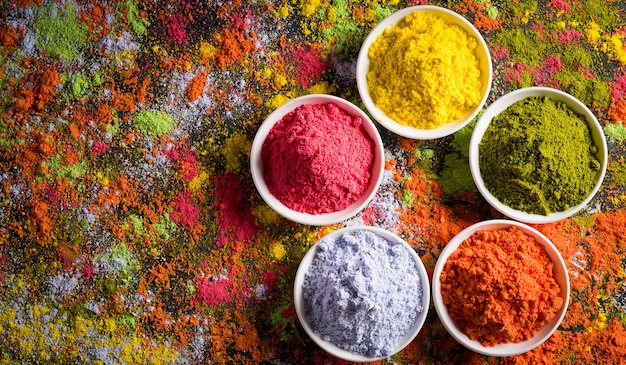 Traditional indian holi colours powder decoration with paints.