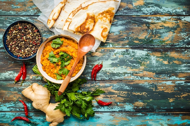 Traditional indian lentils dal, naan butter bread