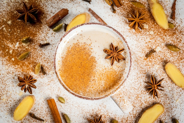 Traditional indian masala chai tea with spices  cinnamon, cardamom, anise, white . top view copyspace