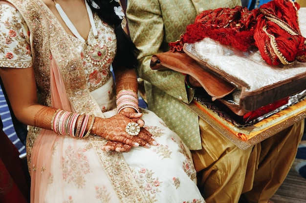 Traditional indian wedding dress for bride and attire for groom