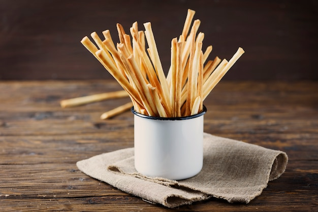 Traditional italian bread sticks  grissini on the wooden table, selective focus and copyspace