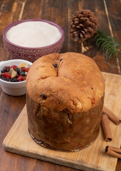 Traditional italian christmas fruit cake over wooden board