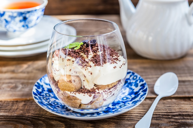 Traditional italian dessert tiramisu in a glass jar