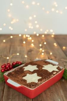 Traditional italian dessert. tiramisu with christmas decoration. vertical format. copy space.