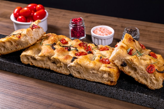 Traditional italian focaccia with cherry tomatoes and olives