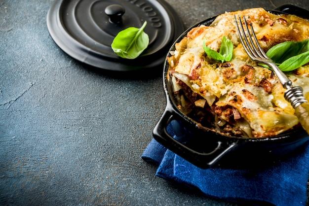 Traditional italian food, homemade lasagna with fresh basil