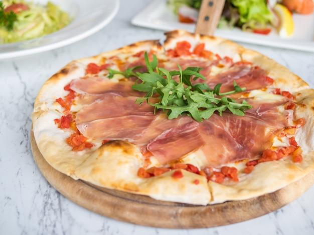 Traditional italian fresh prosciutto parma ham pizza.
