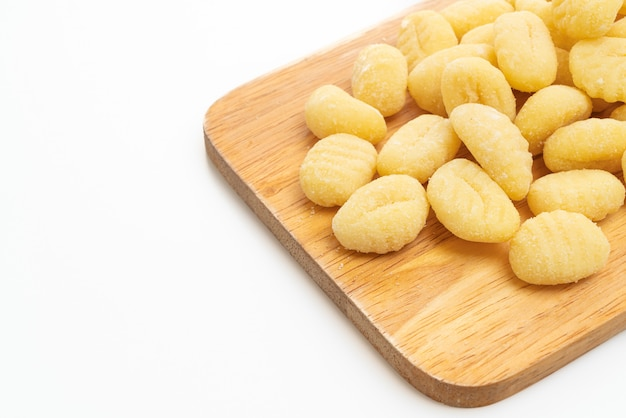Traditional italian gnocchi pasta uncooked isolated on white
