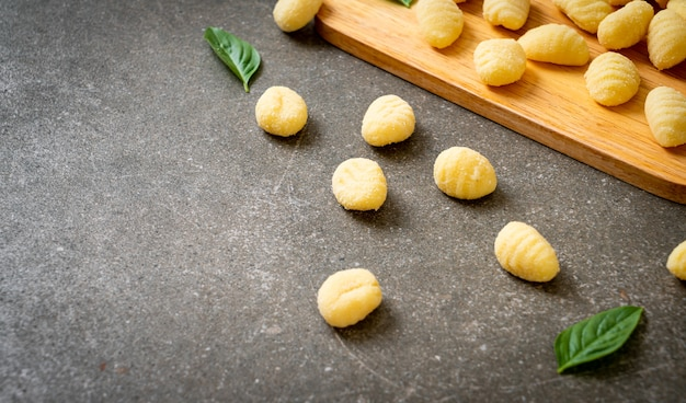 Traditional italian gnocchi pasta uncooked - italian food style