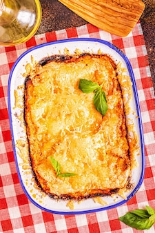 Traditional italian lasagna with vegetables, minced meat and cheese