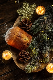 Traditional italian panettone with pine branches
