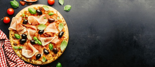 Traditional italian pizza on dark table